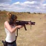 Girl Shooting an MP5