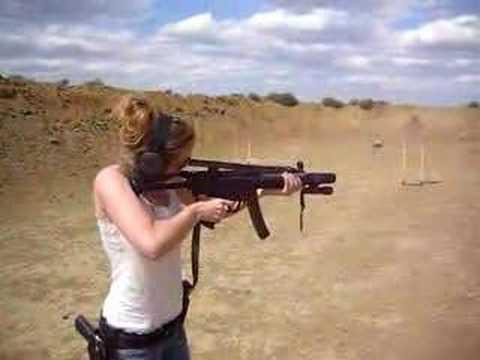 Girl Shooting an MP5
