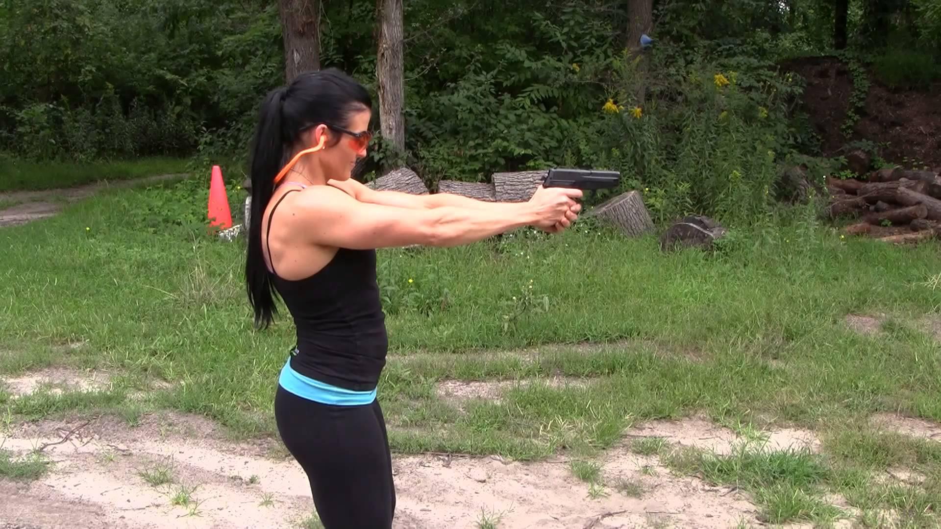 Rebekah Saryn Shooting a Sig P228