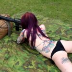 Bobbie Shooting a Colt AR-15 Rifle